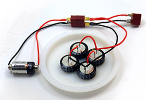 With super caps to buffer SD write events, you can drive the loggers with a very small battery. Rare earth magnets let you connect to the ends without a holder and you can make a multi-layer magnet/button cell sandwich to build low power options at just about any voltage. Those are 5v 1farad supercaps in series, so I don't bother to balance them as they should be able to handle leakage asymmetry when the battery input is only 5.6 volts