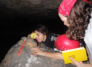 Fernanda taking readings from a known survey station out to a drip logger